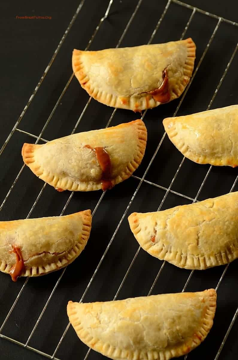 Baked apple hand pies on a rack