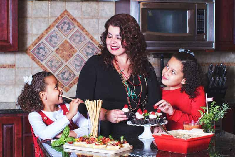 Denise with her kids eating in then kitchen
