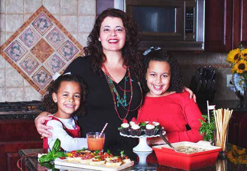 Denise with her daughters in the kitchen cooking food