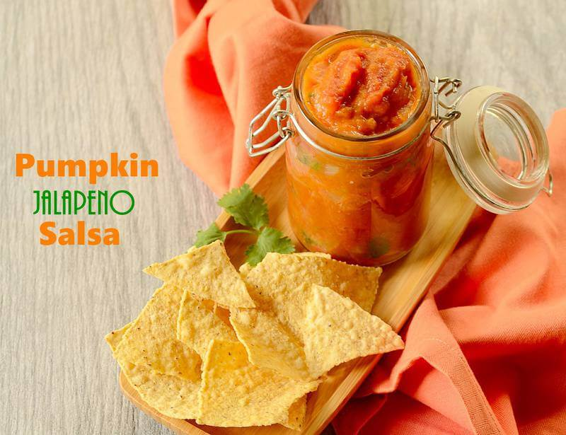 pumpkin jalapeno salsa in a jar with tortilla chips on the side