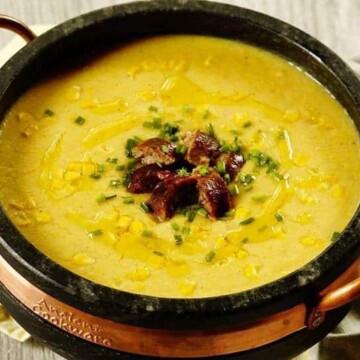 A bowl of corn chowder (close up)