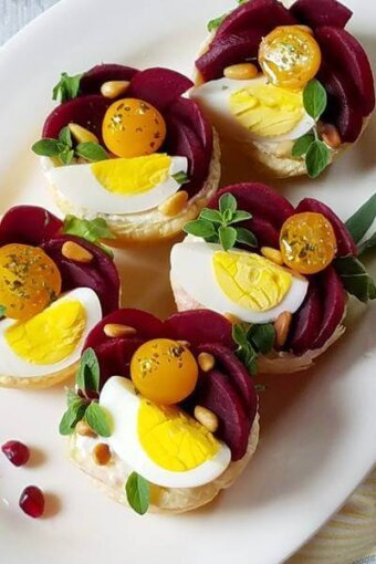 A plate of goat cheese tartlets (close up)