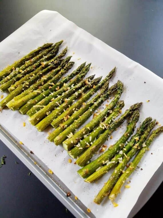 roasted asparagus on a lined sheet pan
