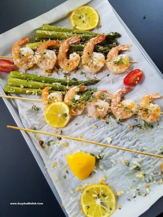 shrimp and asparagus skewers partially eaten