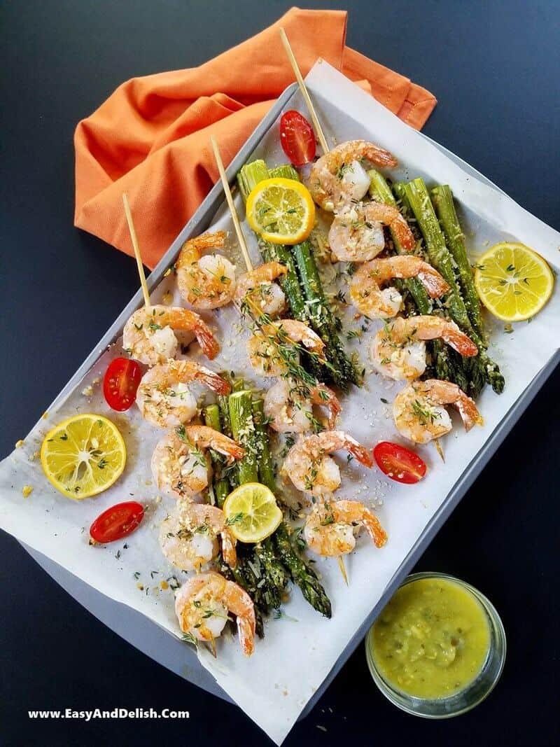 one pan with skewers of shrimp and asparagus