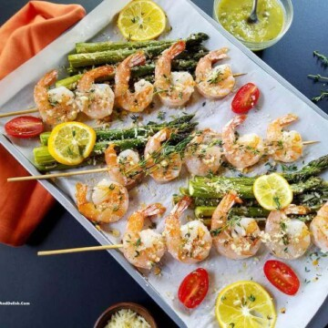 Parmesan shrimp skewers ina  baking sheet