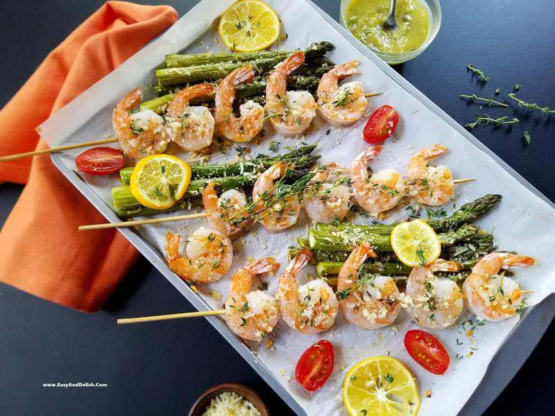 Parmesan shrimp skewers ina  baking sheet