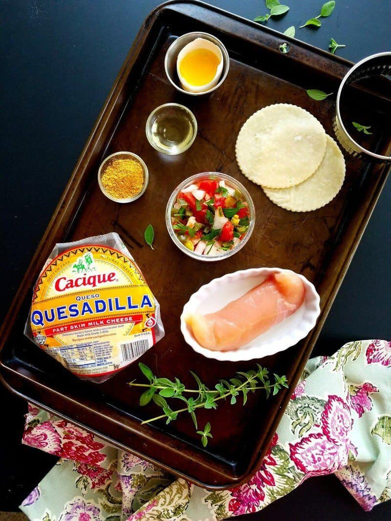 Food on a table, with ingredients for Empanadas