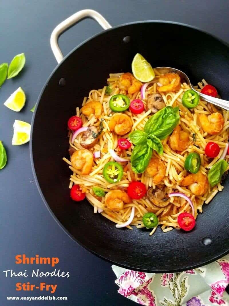 shrimp thai noodles stir fry in a wok pan