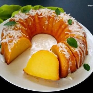 magic custard cake partially sliced in a plate