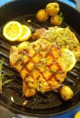 A pan of grilled pork chops with Chimichurri plus mini potatoes