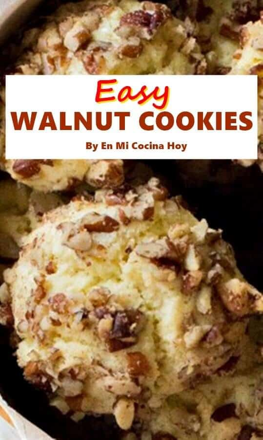close up image of one of several walnut cookies