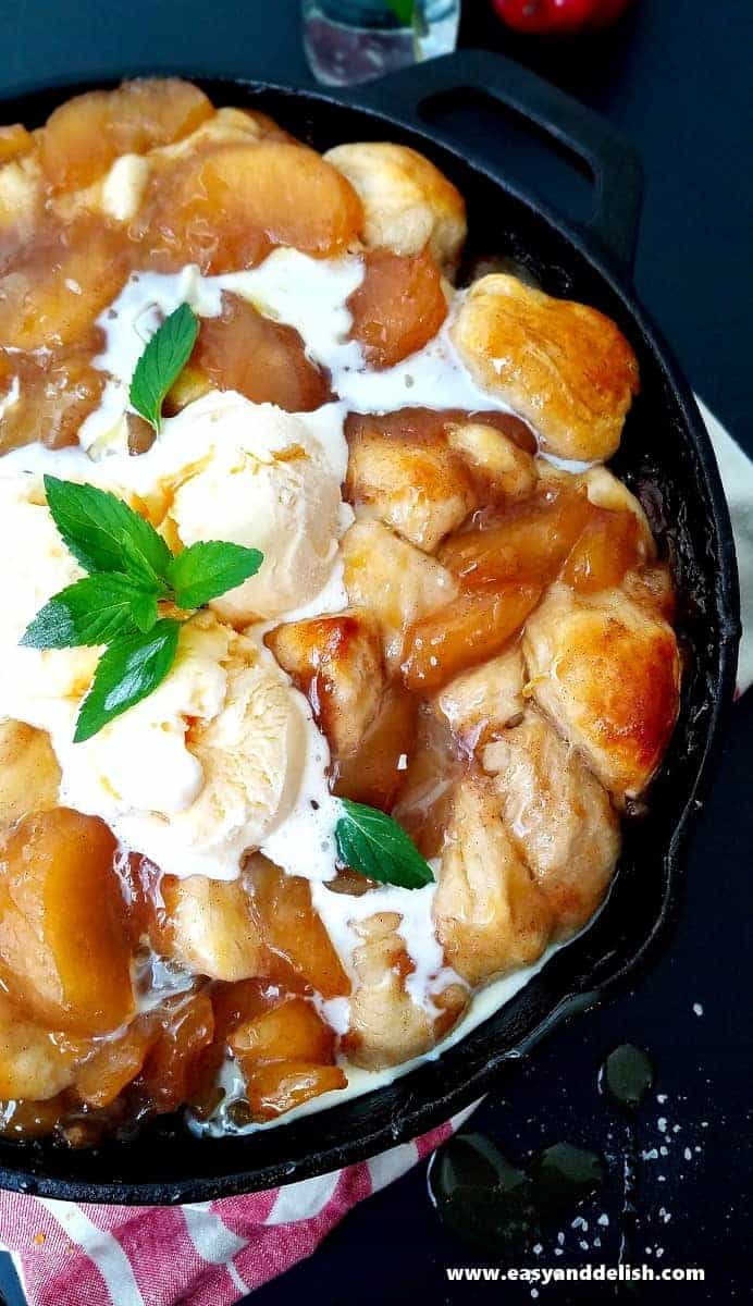 close up image showing apple pie cobbler with ice cream