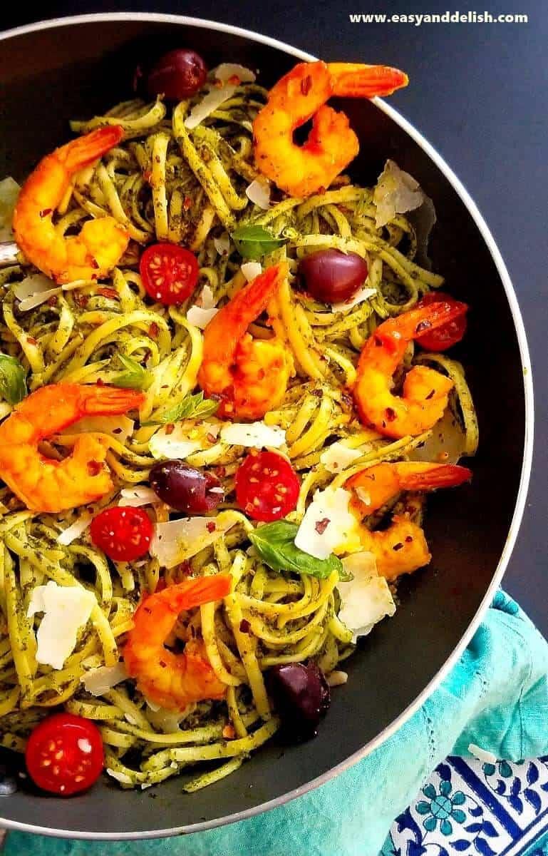 A skillet of kale pasta with shrimp