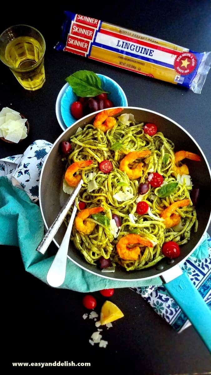 a skillet of kale pasta with shrimp and veggies