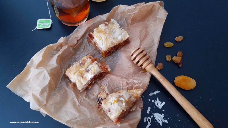 nut-free baklava over parchment paper with a cup of tea