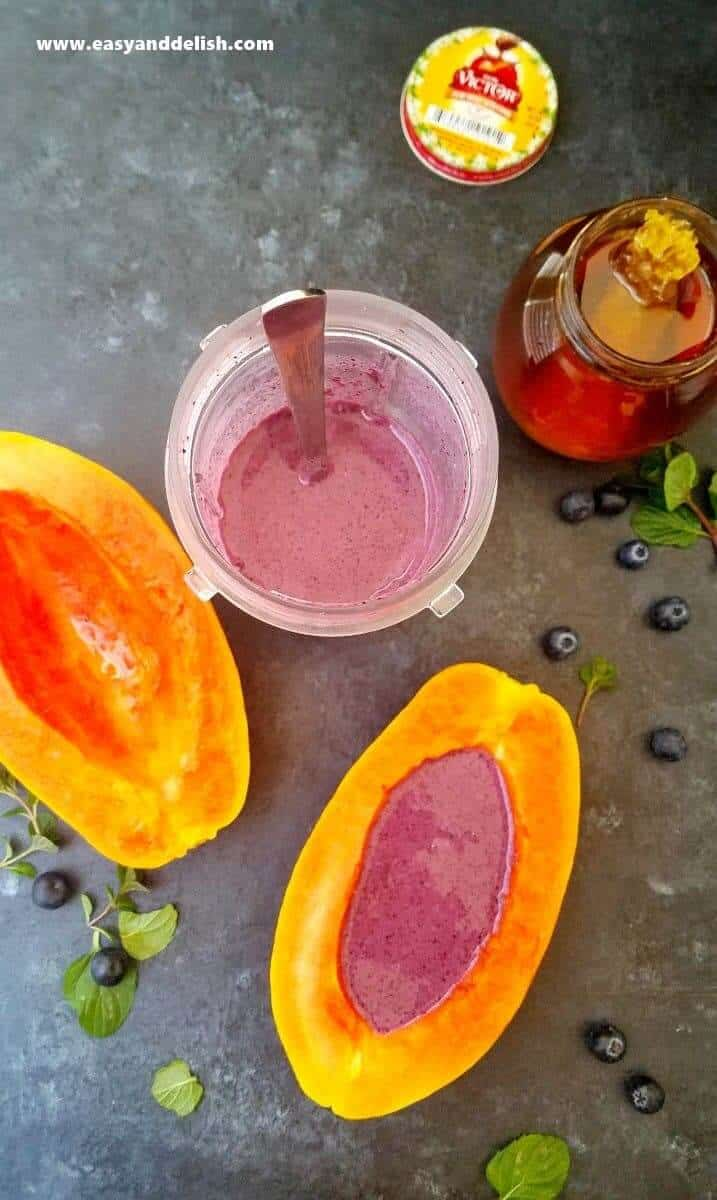 papaya halves a cup of smoothie plus a har of honey