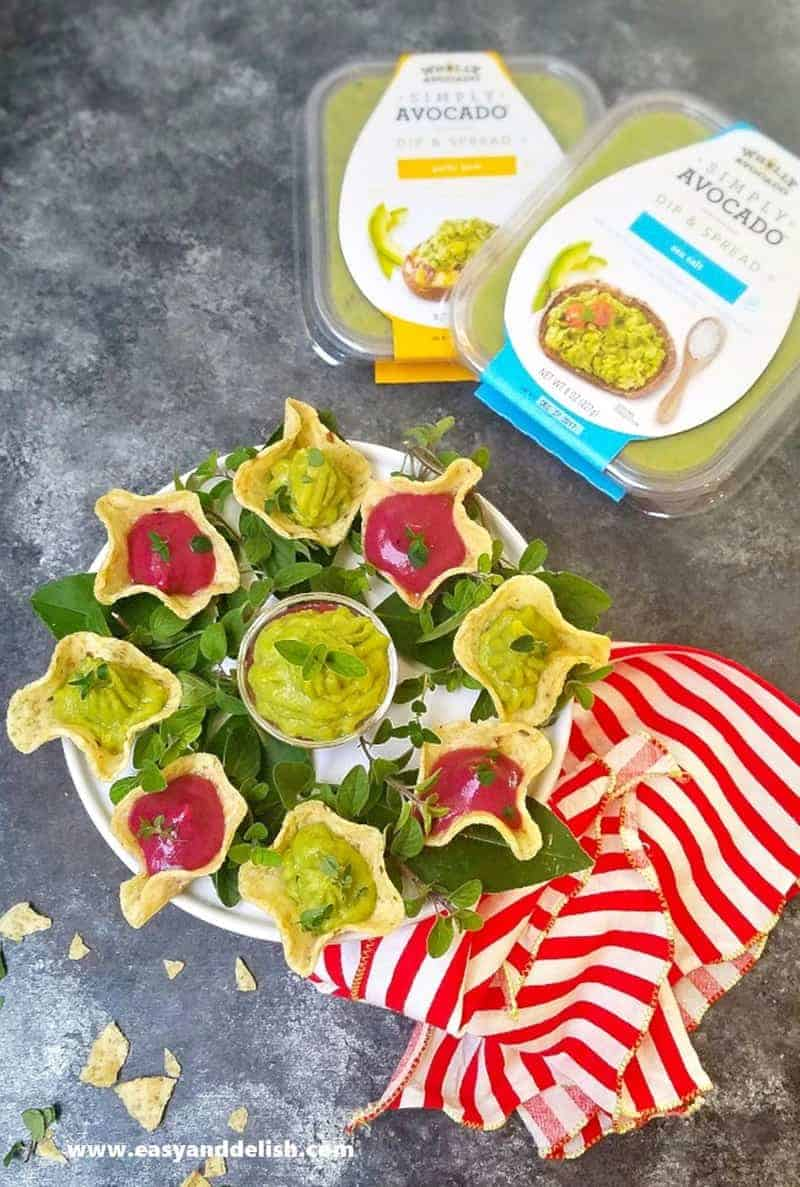 A tray of cranberry avocado dip with packages on the background