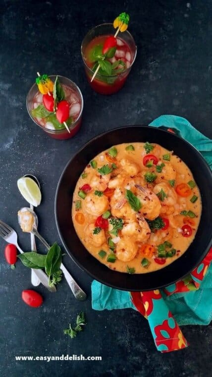 one pot Brazilian shrimp stew in a bowl served with drinks