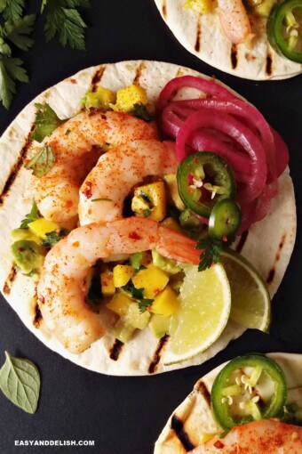 spicy shrimp tacos with flour tortillas and sides