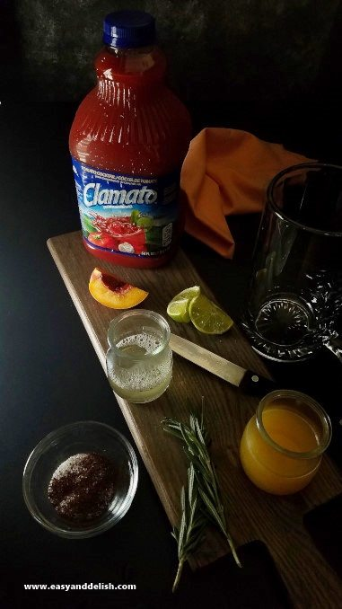 Display of ingredients of peach rosemary michelada