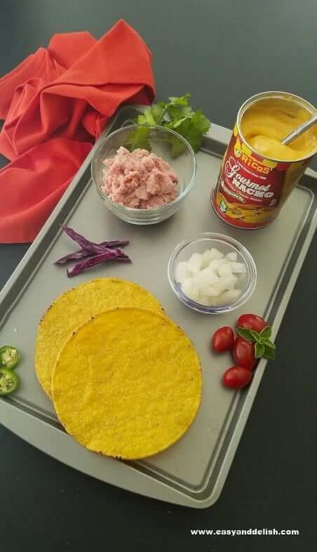 Sheet pan displaying all the ingredients of queso burger tostadas