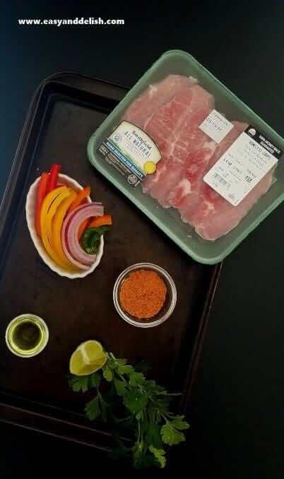 Ingredients of pork fajita bowl on a table