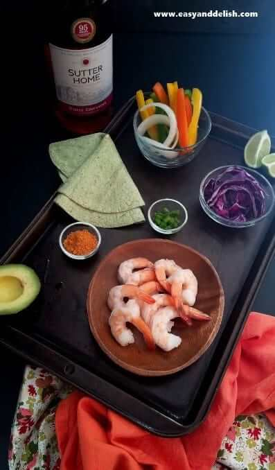 Ingredients of spicy taco shrimp fajitas on a table