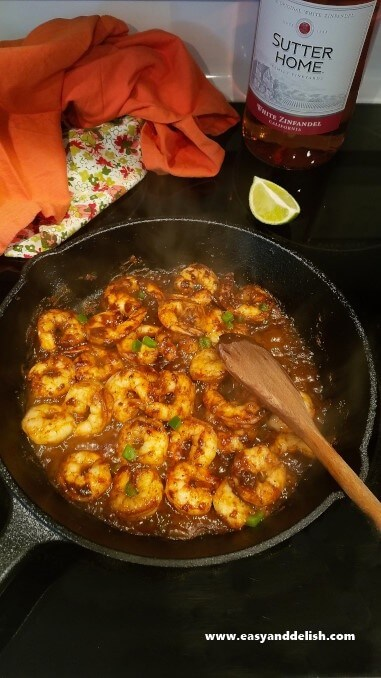 Shrimp being cooked in a skillet on stovetop