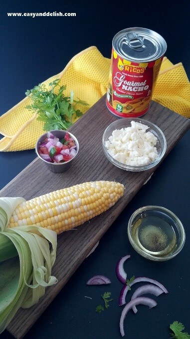 Ingredients of nacho grilled corn on the cob on a table