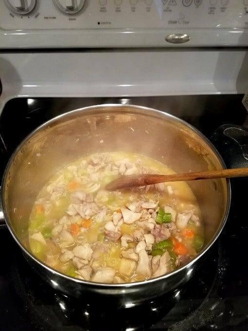 Preparing Mediterranean chicken pot pie -- cooking vegetables and chicken