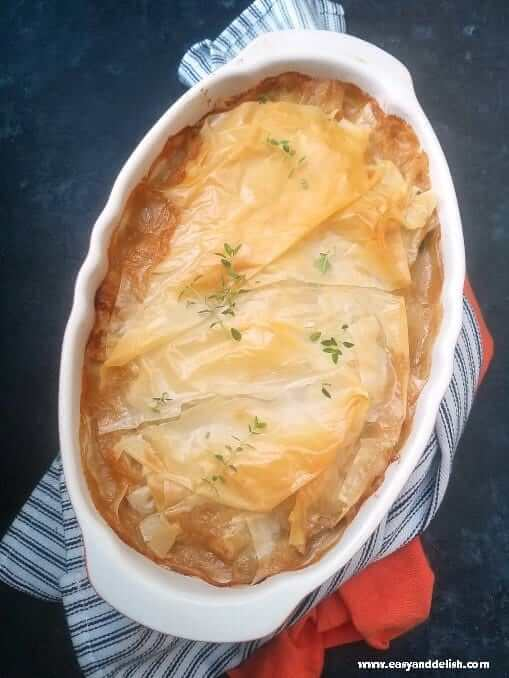 Mediterranean chicken pot pie in a baking pan