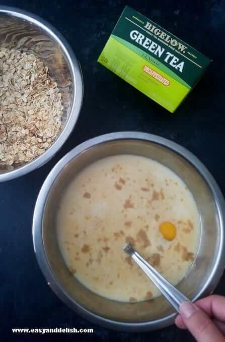 Two bowls, one with dry ingredients and other with wet ingredients to make apple spice baked oatmeal