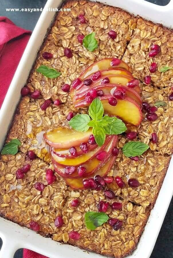 Close up image of apple spice baked oatmeal with caramelized apples and pomegranate seeds