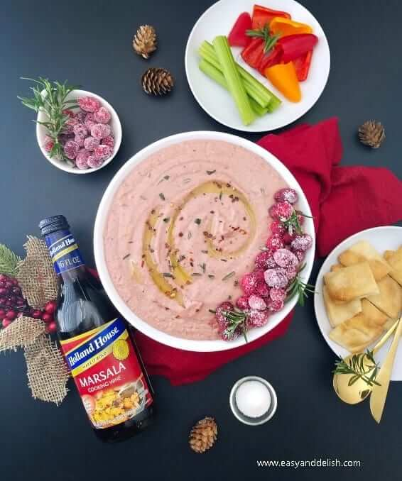 Cranberry hummus dip on a holiday table/meal setting