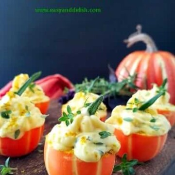 a bunch of pumpkin deviled eggs in a platter