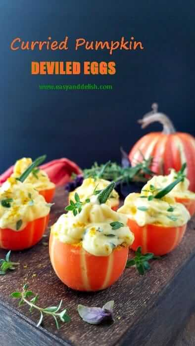 curried pumpkin deviled eggs on a serving tray