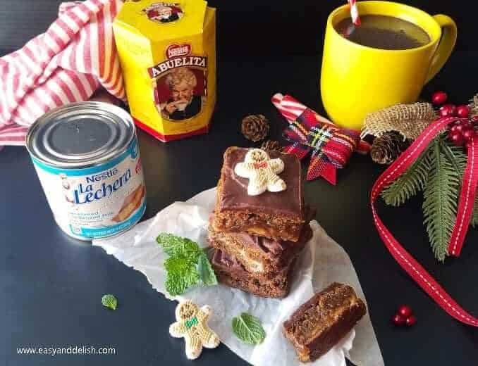 A pile of gingerbread cookie bars served with hot chocolate