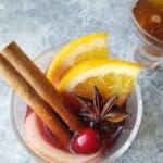 A glass of mulled wine garnished for the holidays