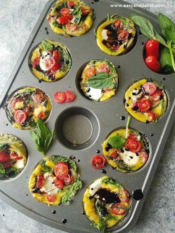 caprese breakfast egg cups in a muffin tin