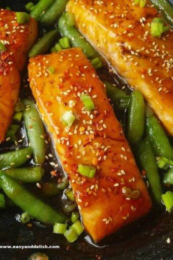 close up of teriyaki salmon with sugar snap peas