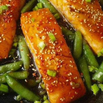 close up of teriyaki salmon with sugar snap peas