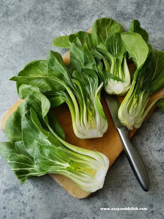 halved bok choi on a cutting board