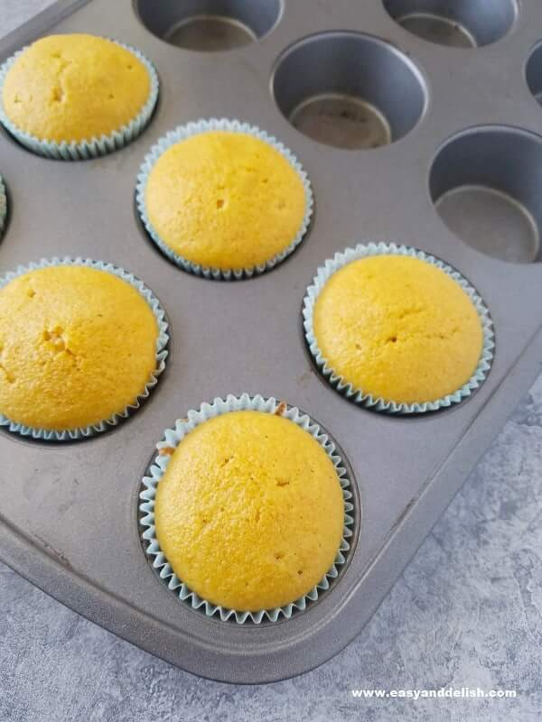 just baked carrot cupcakes in a muffin tin