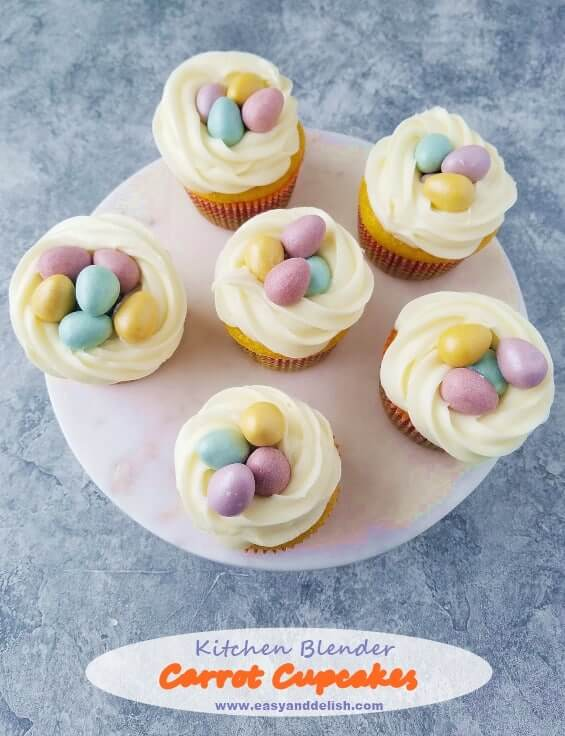 Six carrot cupcakes decorated for Easter in a platter