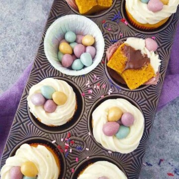 Brazilian carrot cupcakes decorated for Easter in a muffin tin