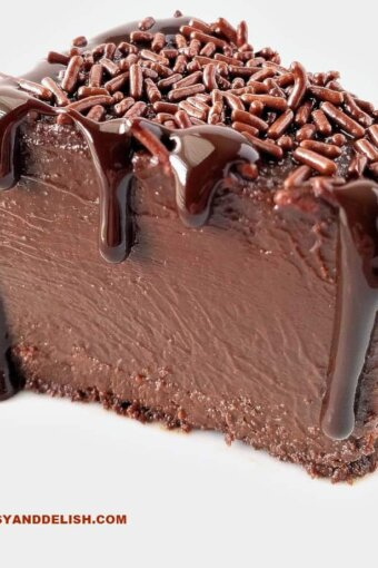 A close up of a slice of brigadeirao with chocolate sauce pouring from top to bottom