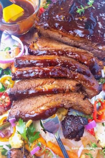 A close up of beef brisket with veggies