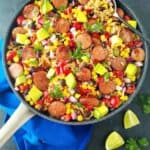 A pan with black bean and rice plus sausage and veggies