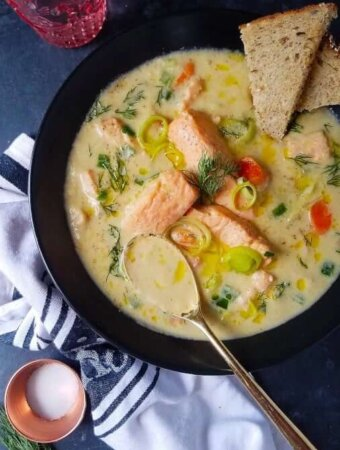 fish soup in a bowl served with bread